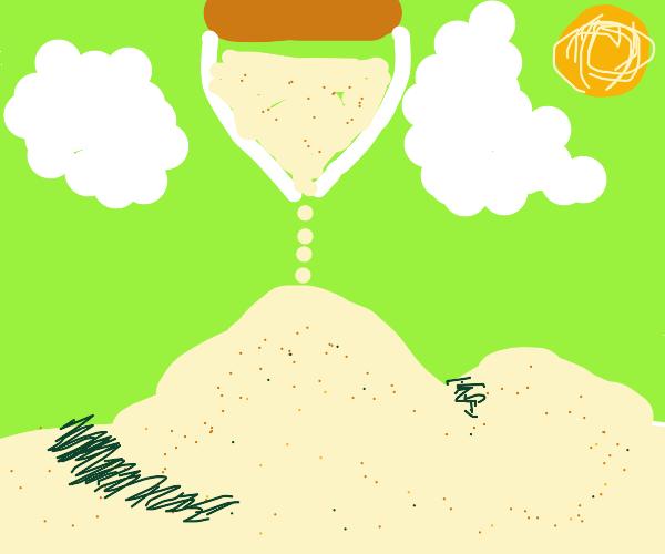 giant sand timer fills desert