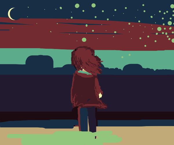 Woman peers into calm night sky