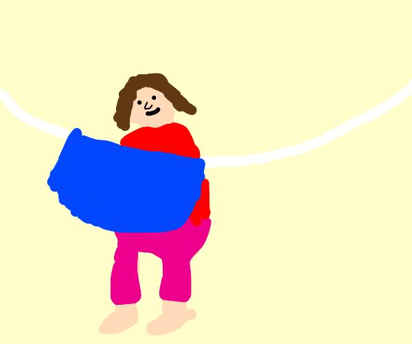 happy woman hangs a blue cloth