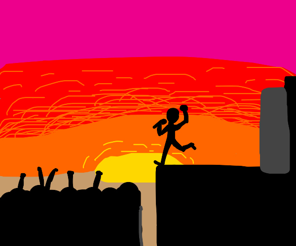 Rock concert in silhouette in front of sunset