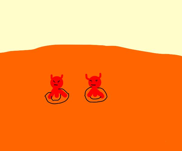 Two devils swimming in orange juice
