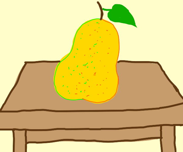 Yellow pear on a wooden table