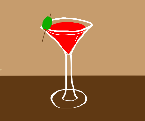 red drink in martini glass with