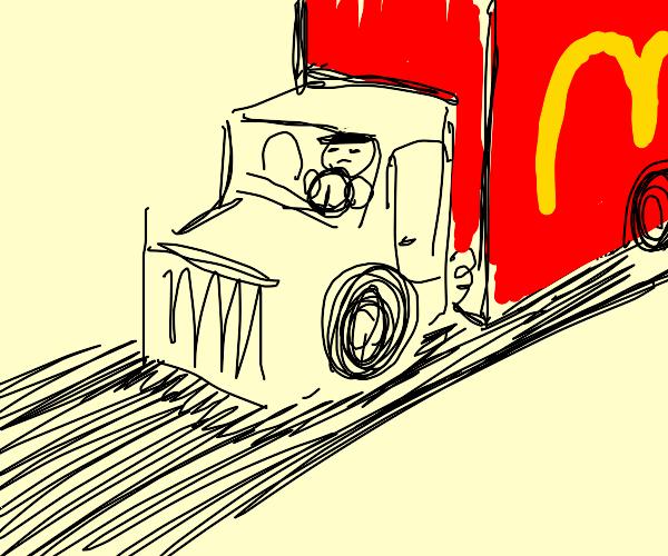 Man driving a McDonald's truck