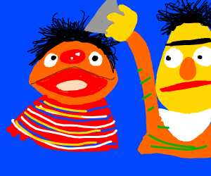 Ernie places a grey triangle on Bert's head.