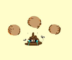 3 falafel around a sad poop