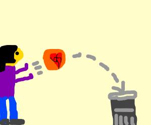 She threw her broken heart into the trash