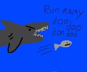 fish swimming away from shark