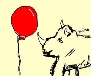 A red balloon next to a rhino