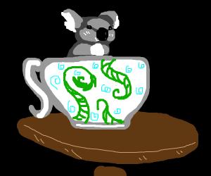 a tiny koala in a fancy teacup