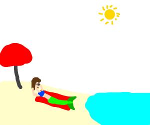 mermaid getting a tan on the beach