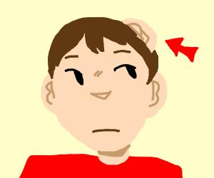 a boy with an extra ear.