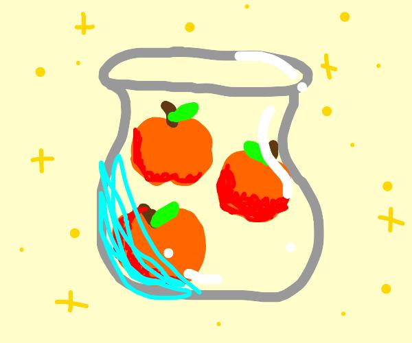 exquisite jar of orange colored apples