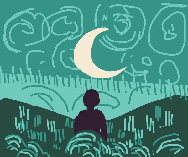 man gazes up at the moon