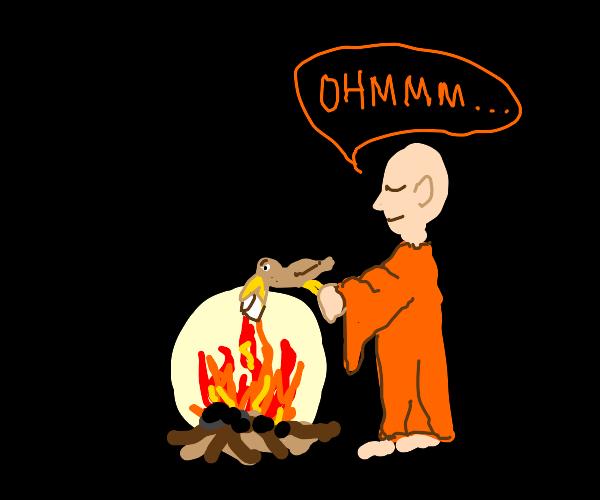 a monk roasts marshmallows using a bird