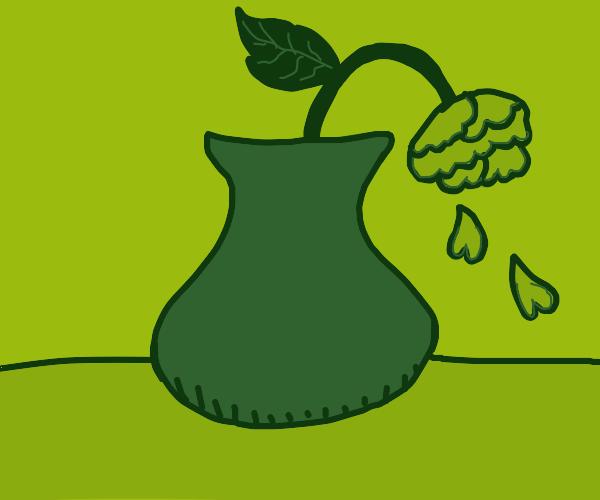 Flower in a green vase