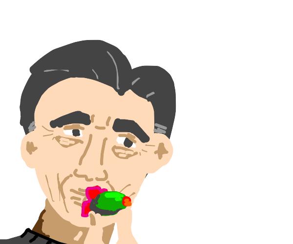 Jim Carrey kisses an olive