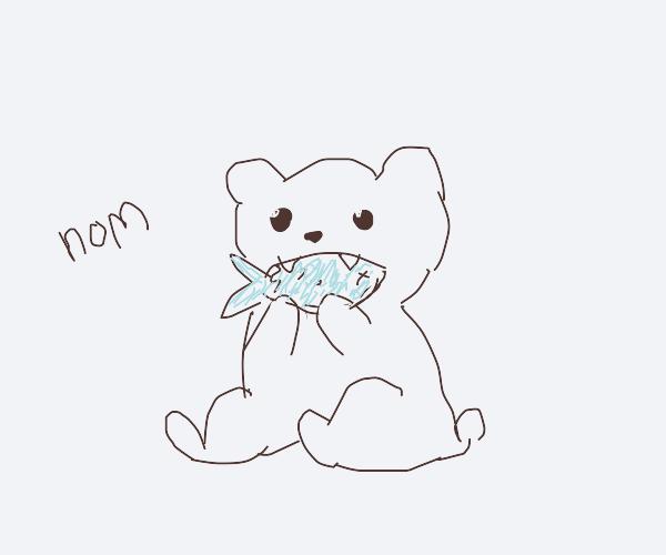 Polar bear caught a fish