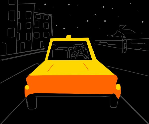 yellow car driving through the night