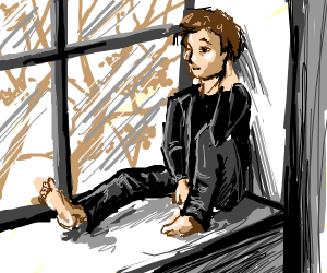 guy sitting and looking out the window