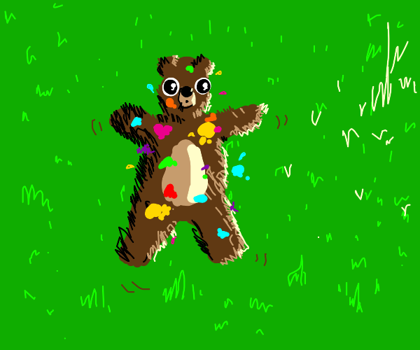 Bear in grass covered in paint