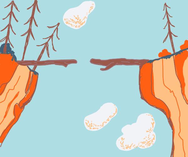 Fallen trees form a path between two cliffs