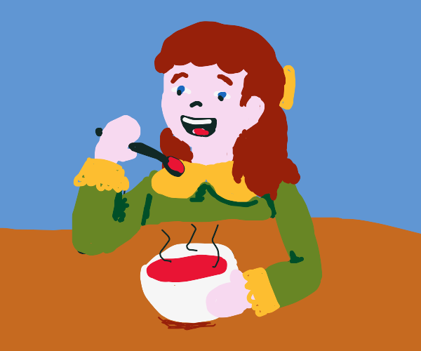 Girl is glad and eats tomato soup