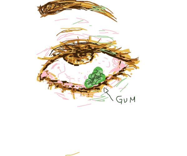 girl putting gum into her eye