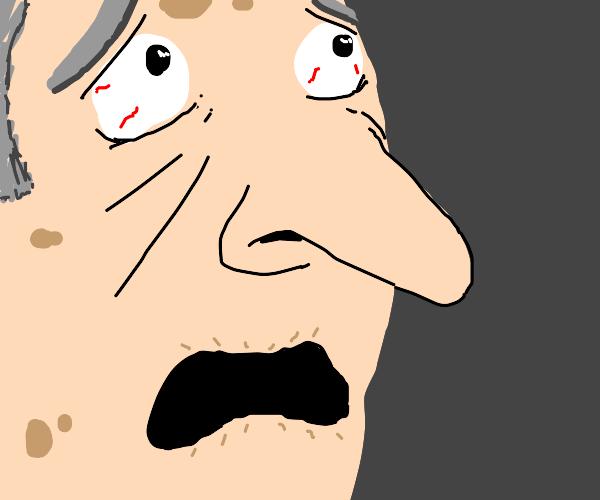 Elderly man is quite shocked, up-close.