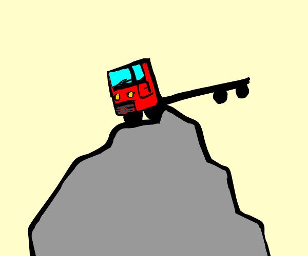 Truck gets stuck on a rock