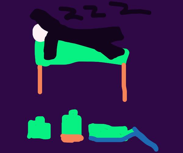 man sleeping with bottles next to him