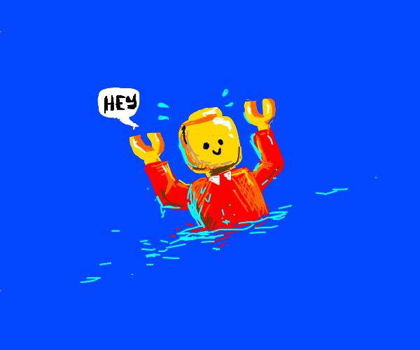 A man has fallen into the river of LEGO city