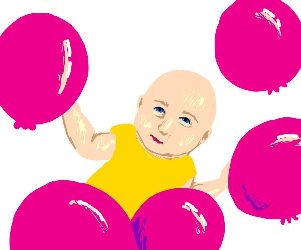 baby looking at balloons