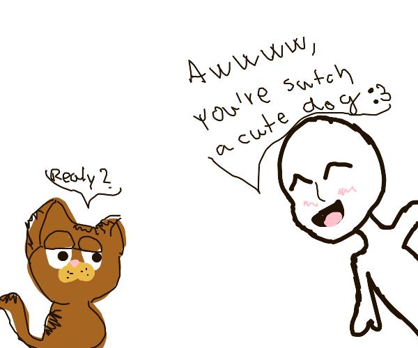 Someone calls Garfield a cute dog