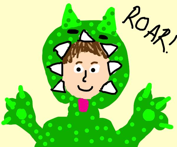 Cute kid dressed as a dinosaur