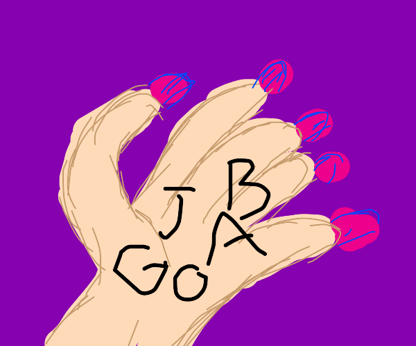 Pink nailed hand holding letters