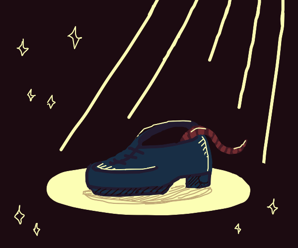shoe with a rat tail under spotlight