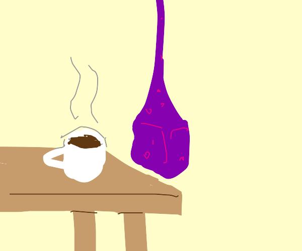 purple transparent hanging cube beside coffee