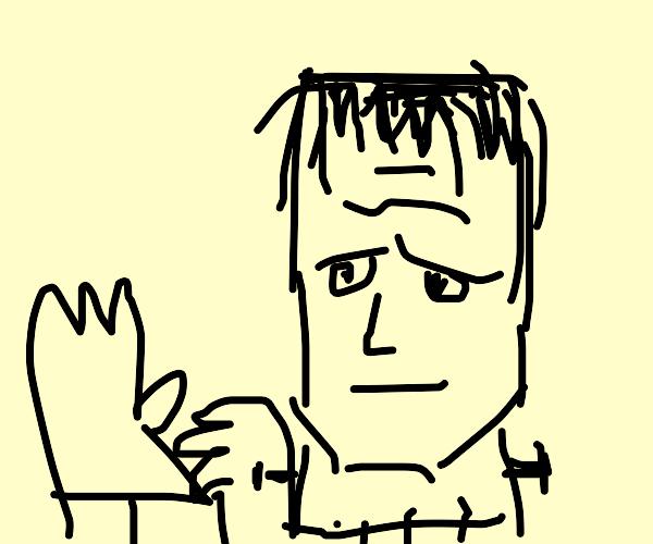 Frankenstein's monster putting on a glove