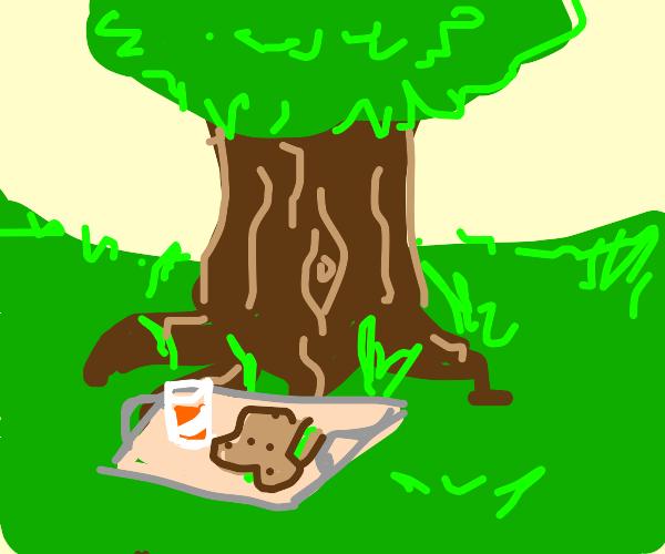 someones breakfeast is under a tree