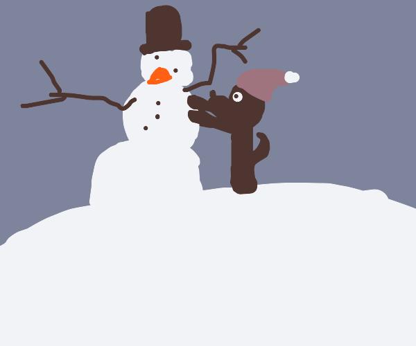 Cute dog builds snowmsn
