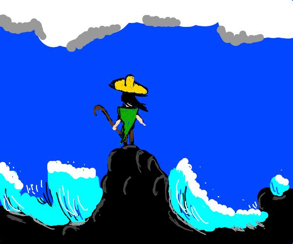 guy wearing sombrero and crown making it rain