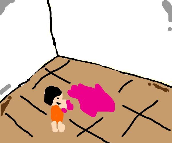 child spreading jelly across the floor
