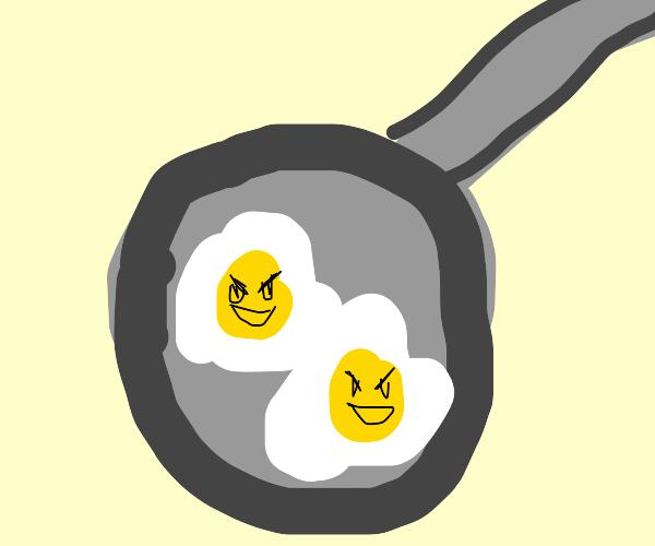 evil eggs in a pan