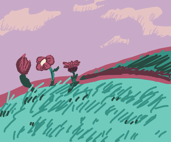 three red flowers in the midst of a field