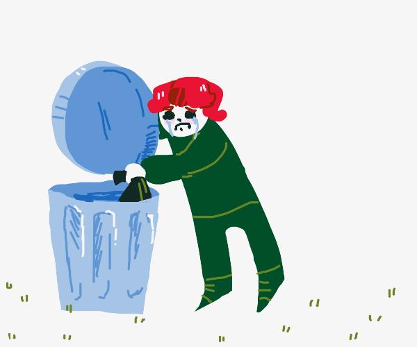 Sad man throwing away trash