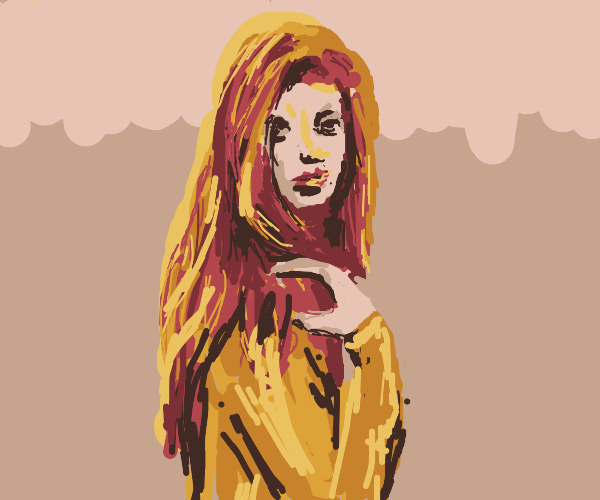 A red headed girl with a yellow shirt on