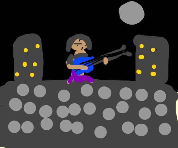 Moon shining over guitarist