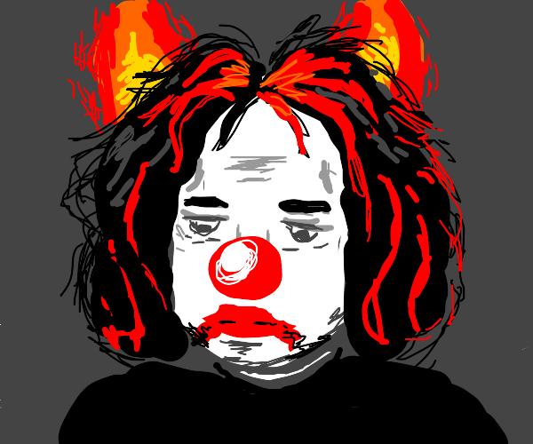 A tired clown w/ fire horns, red/black hair