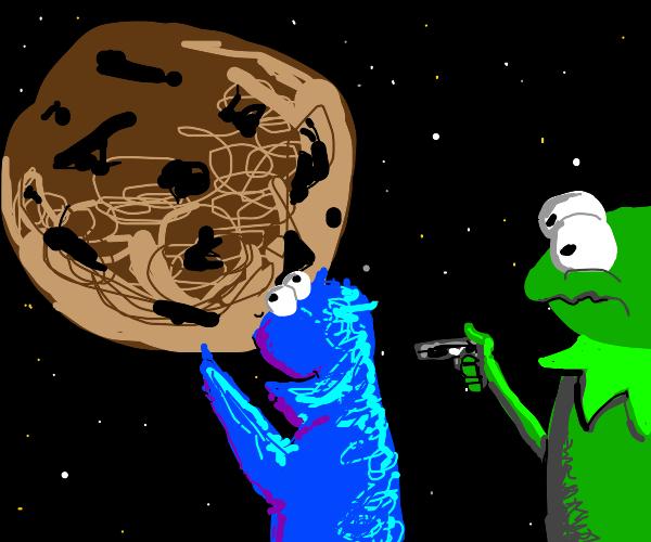 Kermit shooting cookie monster